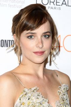 Dakota Johnson opted for a minimal makeup look with long, defined lashes
