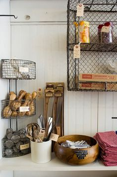 Chicken wire accessories and shelving with bead board, for the country look. Could be quite lovely if you did the distressed paint job below in white or cream.