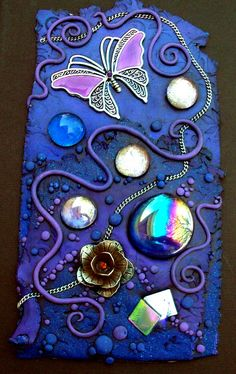 A closeup view of a journal I decorated with polymer clay, glass gems, a bit of silver chain, iridescent glass cubes and a metal flower and butterfly. Fimo Clay, Polymer Clay Projects, Polymer Clay Creations, Polymer Clay Crafts, Clay Tiles, Sculpture Clay, Diy Arts And Crafts, Altered Art, Biscuit