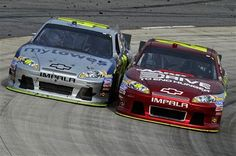Jimmie Johnson (48) and Jeff Gordon (24) race closely through Turn 4 during the NASCAR Sprint Cup Series auto race at Martinsville Speedway in Martinsville, Va., Sunday, April 1, 2012.