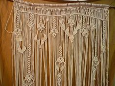 macrame!  I want this to hang above my see thru shower door, attached to the Ikea hooks that slide back and forth, with a boxed valance above