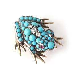 A turquoise, ruby and diamond 'Frog' brooch, late 19th century.