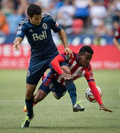 Vancouver Whitecaps' Steven Beitashour, left, collides with Chivas USA's Marvin Chavez, of Honduras, during the first half of a soccer game,...