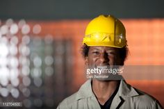 Stock Photo : Grinning Black worker in hard-hat