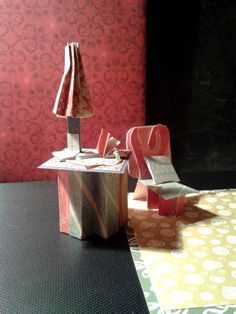 side table with lamp and bits & bobs...chair with cushion...