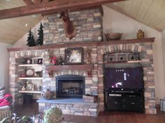 Our stone fireplace/entertainment center. Kill two birds with hundreds of stones!