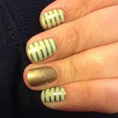Love this gold and mint manicure!!! Mint green and gold stripe with gold sparkle from jamberry. Check them out at carissac.jamberry.com