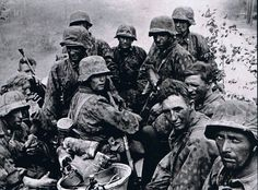 Battered battle-weary German soldiers of the 3rd SS Division 'Totenkopf' (Death's Head) during the battle of Kursk where countless German divisions met heavily fortified and defended Soviet positions. [960x711]