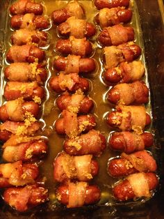 Bacon wrapped smokies 1pkg of Cocktail weiners Bacon,sliced 1/4-1/2cup brown sugar 4T butter,melted  Wrap smokies in bacon. Place in dish. Sprinkle with brown sugar. Pour butter over top. Bake 325 for 40mins #fbdinnerclub