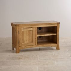 Orrick Rustic Solid Oak TV Cabinet  Transform your living room with the Orrick Rustic Solid Oak TV and DVD Cabinet. Sculpted by skilled artisans from the finest oak timber it's effortlessly stylish.