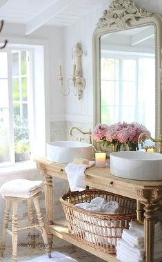 Round Sinks and an Ornate Mirror