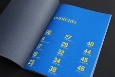 LOVE the blue and yellow against the gray on the opposing page. interesting table of contents. I dig the modern typeface for the numerals and other copy with a classy serifed font. big. bold. effective.