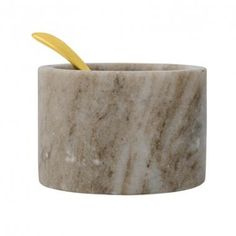 Salt dish sculpted out of marble with a contrasting brass spoon. deep x high capacity; size may vary somewhat Rubber protectors on base Hand wash only Note: Marble pattern and veining varies from piece-to-piece