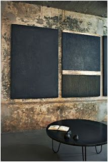 laboratorio avallone - reversing the focal point... love the walls and contrasting black paintings....
