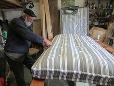 MATTRESS MAKING  Graham at work on single mattress using French ticking