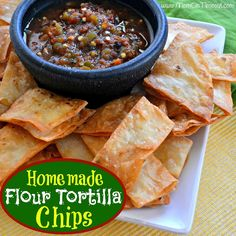 Homemade Flour Tortilla Chips Recipe - Mom On Timeout - The texture of a flour tortilla chip is so much lighter and flakier than corn tortilla chips and I think you'll find it truly delightful. Mexican Food Recipes, Real Food Recipes, Snack Recipes, Cooking Recipes, Yummy Food, Mexican Meals, Mexican Dishes, Budget Recipes, Flour Tortilla Chips