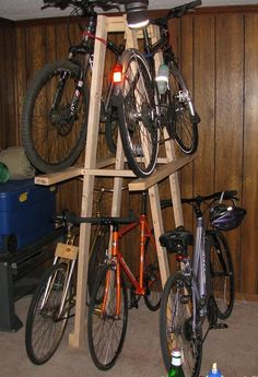 This is a wooden rack I built to store 5 of my bicycles. It is constructed of 2x4 and 2x2 lumber assembled with glue and screws and the shelves are na...