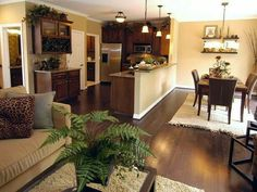 hardwood flooring with eco-friendly area rugs and modern cabites and dining table design in kitchen design for home and advice for home furniture and home decoration 42 Style At Home, Living Room Kitchen, Living Rooms, Kitchen Nook, Kitchen Small, Open Kitchen, Design Case, Big Design, Open Floor