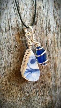 Rare Blue Textured Sea Glass and Chaney Pottery Piece Wire Wrapped Necklace. $17.00, via Etsy.