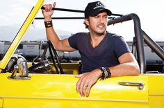 Luke Bryan in his neon yellow vintage Ford Bronco