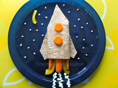 Rocket kids lunch by CreativeKidSnacks.com | Turkey breast in a whole wheat tortilla wrap (high fiber and protein) with carrots & yellow peppers.  Made this for my own kids using technique shown in post with unsweetened GREEK yogurt and they ate it all up!