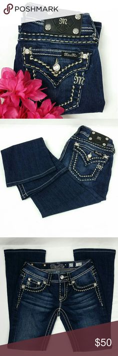 """Miss Me Bootcut Jeans 25x28 Miss Me Jeans Size 25. Professionally hemmed inseam to 28"""" Style# JS5014B89 Bootcut, Mid-rise Dark wash with Gold stitching.  Blingy rhinestones embellishment on front and back flap back pockets.  These jeans are in excellent condition.  No rips, stains or tears. Washed and ready to wear. Miss Me Jeans Boot Cut"""