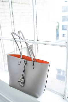 Reversible grey/coral tote with cool tassel detailing