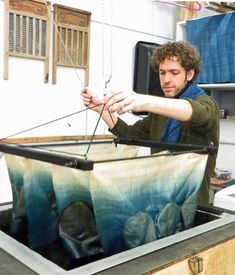 Rowland Ricketts dyeing cloth, The artist runs Ricketts Indigo along…