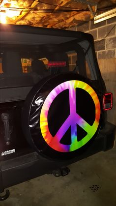 peace sign in tie dye spare tire cover