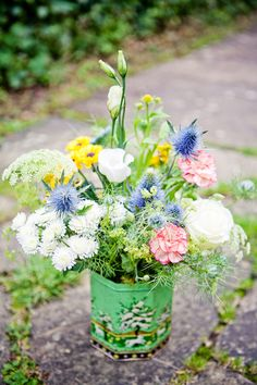 To complete your garden theme wedding,  this is a perfect match for your ceremony decor a vintage tin can with flowers and foliage.