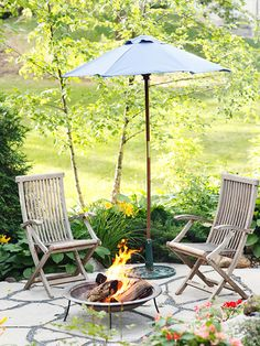 Let There Be Fire  Create a cozy ambiance in your yard with a fire pit. A portable unit like this one is a budget-smart way to add in the feature. Or, if you're looking to invest a little more money, consider a built-in fire pit that is sunk into the ground.