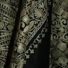 kashida is traditionally sewn with threads of pastel or brighter shades but here, metallic shades have been used on black wool.