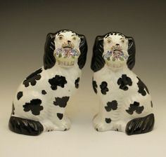 PAIR STAFFORDSHIRE POTTERY DISRAELI SPANIELS WITH BASKETS