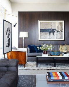 In the living room, the custom-made sofa is upholstered in a Holly Hunt cotton, the armchair is Swedish, the rug is Moroccan, and the vintage cocktail table is by Michael Taylor for Baker.