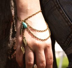 Slave Bracelet Hipster Bronze Chain Bohemian Feather Leaf Charm Turquoise Bead Ring Finger Hand Jewelry Piece. $17.00, via Etsy.
