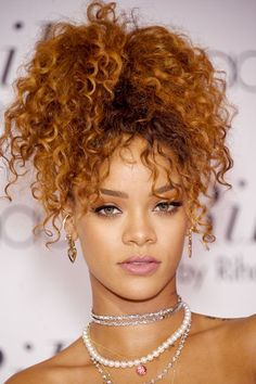16 Ways To Transform Your Hair Without Cutting It #refinery29 http://www.refinery29.com/fake-bangs-faux-bob-hairstyles#slide-7 Fake Fringe The pineapple style is an easy way for curly-haired girls like Rihanna to have bangs for the night. To get the look, leave out the front third of your hair, and tie the back two-thirds into a high ponytail. Flip over the ponytail toward the front of your hair, blend it with the front section, and secure with a pin or two. Push forward the curls in the…
