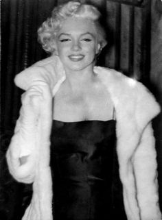 """""""A rare photograph of Marilyn Monroe at """"Club 21″ for a party given for John Huston, 1955. """""""