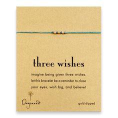 three wishes gold-dipped stardust bead bracelet on turquoise irish linen $26