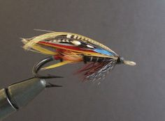 This Jock Scott was tied c. 1920 and is part of a collection from the New England Aquarium donated to the Museum in 1976. While hooks with metal eyes were readily available at the time this fly was created, silkworm gut eyes, such as the one sported by this fly, remained a popular option for professionally dressed salmon flies well into the 1900s.