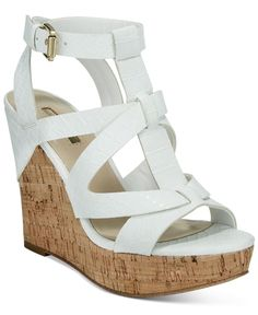 Go bold on your night out with the strappy, caged details and cork platform wedge on these Harlea sandals from Guess. | Manmade upper; manmade sole | Imported | Round peep-toe ankle-strap caged platfo