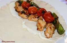 Chicken Tawook - Rolling the Chicken, Garlic Paste and Veggies in a Pita Bread