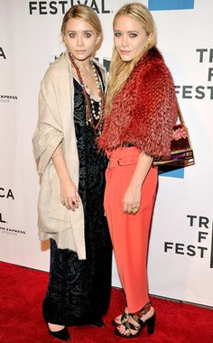Ashley Olsen's Best Looks  Ashley keeps herself—and her embroidered dress by The Row—covered by a huge beige scarf at the 2011 Tribeca Film Festival. Come on, give us a peek!
