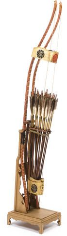 A bow, quiver and arrow set Edo period (19th century) Comprising two laminate wood bows wrapped in lacquered rattan and twenty fletched arrows all fitted into a carrying rack and gilt leather and wood quiver lacquered with floral crests in black and red; with display stand 51 3/8in (130.4cm) high (including stand)