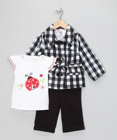 With a coat for cool days and a charming tee for when a jacket is too warm, little fashion fans will be content to bask her in their cute-couture. Don't forget the accessories—a bright bow for her hair to match!Includes tee, jacket and pantsCoat: 100% polyesterTee and pants: 100% cotton
