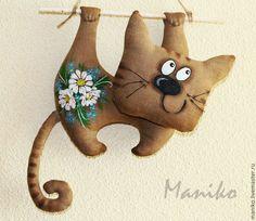 vysící kočka
