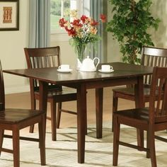 East West NFT-MAH Norfolk rectangular table with 12 in. Butterfly Leaf -Oak Finish. - Mahogany by East West. $104.09. Needs to be assembled.. Length: 54. Material: Rubber solid woodDimensions:. Width: 32. Height: 29.5. Dine in luxury and traditional comfort with Norfolk dining room sets. This dinette set offers quality design with a touch of class to add dynamic appeal to any dining room or kitchen. A convenient 12-inch self-storage extension leaf provides extra space. Norfol...