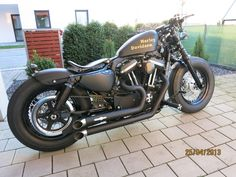 48 sportster, they should make the rear fender and supports shorter from the factory like this.