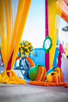 mehendi decor, genda phool decor, floral arrangement for mehendi, colourful mehendi decor