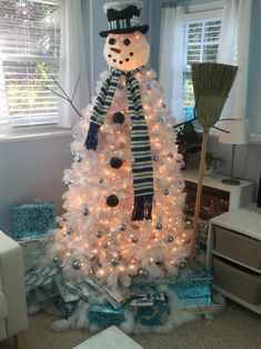 Snowman Christmas Tree!!  Handmade scarf and hat band, redone face components and light blue balls, snow shavings and snowflakes to break up the solid white tree!!!  AWESOME !  Created by UPCYCLED ORIGINALS based on other Pinterest ideas, but by far the best I've seen and done!!