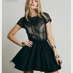 Free people one Lola dress Victorian-inspired mixed lace fit and flare mini with a satin skirt and ribbon cage work throughout the bodice. Features sweetheart lining, smocking at the waist, and a single mother of pearl button closure at the nape. Hidden side zip closure and raw hem. *FP One *FP One is an exclusive collection made with love from India. Defined by bold embellishments and natural-feeling fabrics, the collection brings a modern twist to Old World techniques. Free People Dresses…